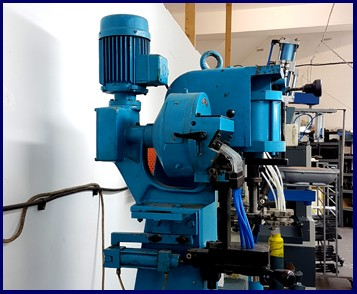 Blue machine shoe making