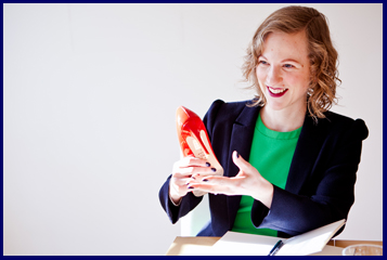 How to start a shoe business Susannah Davda holding a red shoe